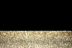 Goldfunkeln mit schwarzem Hintergrund Stockfoto