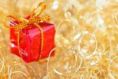 Goldfunkeln-Weihnachtshintergrund Stockfotos
