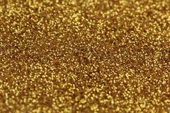 Goldfunkeln-Zusammenfassungshintergrund Lizenzfreies Stockfoto