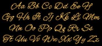 Goldfunkelndes Alphabet der Sternstaubspur Stockfotos