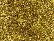 Goldfunkelnhintergrund. Stockbilder