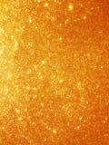 Goldfunkelnhintergrund lizenzfreie stockfotografie