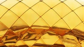 Goldfunkelnhintergrund Geschenkverpackung Zusammenfassungshintergrundbeschaffenheit Lizenzfreie Stockfotografie