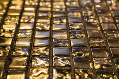 Goldglashintergrund Lizenzfreie Stockbilder
