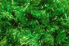 Goldgrünes funkelndes Lametta lizenzfreie stockfotos