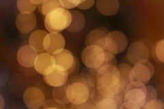 Goldhelles Hintergrund bokeh Lizenzfreie Stockfotos