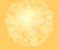 Goldhintergrund mit hellen Kreisen Stockfotos