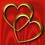 Goldinnere auf roter Seide Lizenzfreies Stockfoto