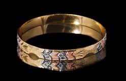 Goldish bracelet Stock Photos