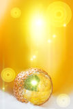 Goldish bright festive background. With a ball Stock Photos