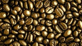 Goldkaffeebohnen Lizenzfreie Stockbilder