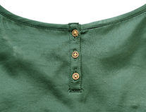 Goldknöpfe auf grünem Silk Stoff Stockfotos