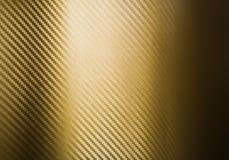 Goldkohlenstoff-Faserbeschaffenheit Stockbild