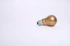 Goldlampe. Stockfotos