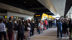 GoldlinQ Light Rail in Gold coast Australia. Commuters lining up to board for the first in the GoldlinQ, a 13-kilometre new light rail system in the Gold Coast Royalty Free Stock Photo