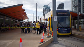 GoldlinQ Light Rail in Gold coast Australia. Commuters lining up to board for the first in the GoldlinQ, a 13-kilometre new light rail system in the Gold Coast Stock Photography