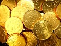 Goldmünzehintergrund stockfotografie