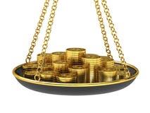 Goldmünzen auf den Skalen. Stockfotografie