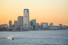 Goldman Sachs Tower en la puesta del sol Fotos de archivo