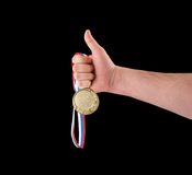 Goldmedaille in der Hand Stockfoto