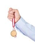 Goldmedaille in der Hand Lizenzfreies Stockfoto