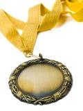 Goldmedaille und -farbband Stockbild
