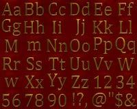 Goldmetall bezeichnet Alphabet mit Buchstaben Stockfotos