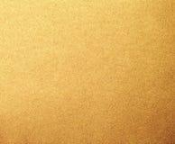 Goldmetallpapier-Beschaffenheitshintergrund Lizenzfreie Stockfotos