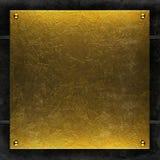Goldmetallplattehintergrund Stockfoto