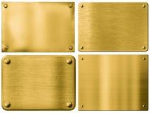 Goldmetallplatten oder -schilder eingestellt mit Nieten Stockbilder