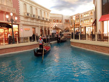 Goldola, river, and Shops Inside the landmark Venetian Hotel in Royalty Free Stock Photo