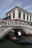 Goldola in Venice and Rialto Bridge Royalty Free Stock Image