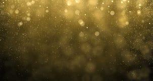 Goldpartikel des Funkelns unten fallling mit hellem bokeh Glanzeffekt geschlungen lizenzfreie abbildung