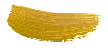 Goldpinsel-Abstrichanschlag Goldener Farbacrylsauerfleck auf weißem Hintergrund Abstraktes Goldfunkelndes strukturiertes glattes  stockbilder