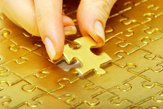 Goldpuzzlespiel stockbilder