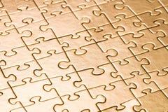 Goldpuzzlespielhintergrund Lizenzfreies Stockfoto