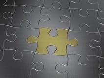 Goldpuzzlespielstück Lizenzfreies Stockbild
