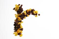 Goldrosine gegen schwarze trockene Rosine Stockbild