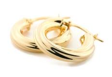 Goldschmucksachen - Ohrringe Lizenzfreies Stockfoto