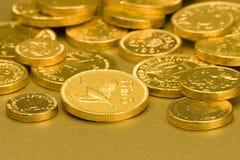 Goldschokoladen-Münzen Stockfotos