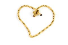 Goldseil mit Herzform Stockbild