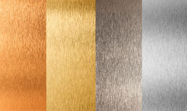 Goldsilbernes Bronzenichteisenmetallset Stockbilder