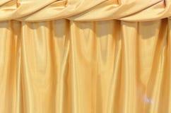 Goldsilk Tischdeckenhintergrund Stockbild