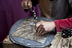 Goldsmith. Artisan metal works and decorate Royalty Free Stock Photography