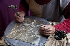 Goldsmith. Artisan metal works and decorate Stock Photography