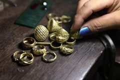 Free Goldsmith Checking Ring After Casting. Stock Images - 118551074