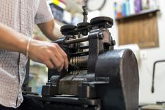 Goldsmith crafting metal Stock Image