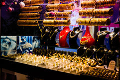 Goldsmith Display Window. Display window of a goldsmith in Cinarcik town which is the district of Yalova city of Turkey. Sets of valuable golden bracelets and Stock Photos