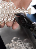 Goldsmith. Making beautiful silver rings Royalty Free Stock Image