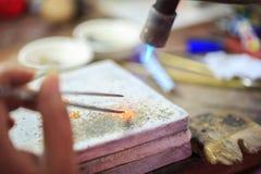 Goldsmith making gold Royalty Free Stock Image